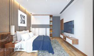 Căn hộ thi công nội thất với trần thạch cao màu trắng, hệ thống đèn được thi công kết hợp với trần. Kiểu bố trí đèn khắp trần nhà như vậy giúp ảnh sáng phân bổ đều hơn, làm sáng căn phòng mà không quá chói. Kệ tivi được thiết kế như một chiếc kệ đặt đồ tối giản, gắn liền với tường nhà.